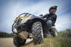 Racing ATV is sand. Stock Photography