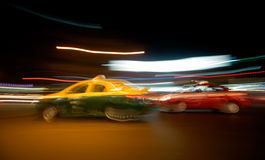 Racing Bangkok Cabs. Taxi cabs speed through the streets of the city royalty free stock photos