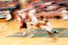 Racing for the basket (motion blur) Stock Images