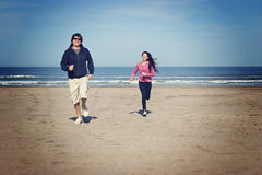 Racing in the beach. Father and daughther runing in a beach of Mar del Plata, argentina Stock Photos