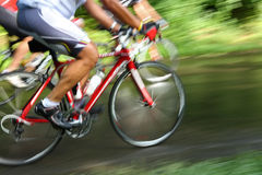 Racing bicycle, motion blur. A bicycle race with multiple riders. The image is a motion blur Stock Images
