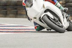 Racing bike rider leaning into on track. Racing bike rider leaning into a fast corner on track Stock Images