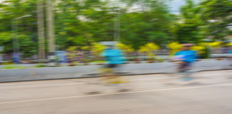A racing bike rider's slow speed shutter Royalty Free Stock Photography