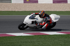 Racing_bike_on_track. Superbike rider racing on a racetrack royalty free stock photo