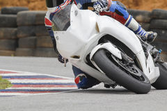 Racing bike on track. Racing bike rider leaning into a fast corner on track Stock Photo