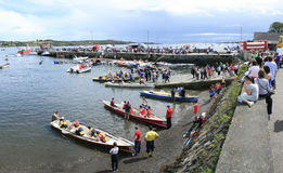 Racing boats in Schull, Cork. Traditional rowing boats preparing for races in Schull, west Cork. Also known as gigs stock image