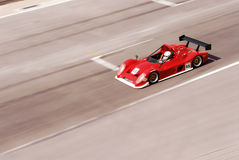 Racing car. A red racing car in action at the track Royalty Free Stock Photo