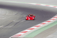 Racing car. A red racing car in action at the track Stock Image