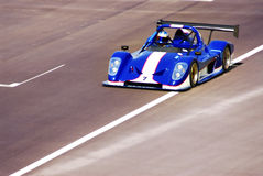 Racing car. A blue racing car in action at the track Stock Photo