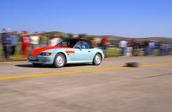 Racing car. Panning image of a speedy car during a legal street race Stock Photos