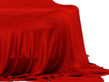 Racing car covered. New racing design car covered with red cloth. 3d rendering illustration. Shallow DOF, shallow focus Royalty Free Stock Images