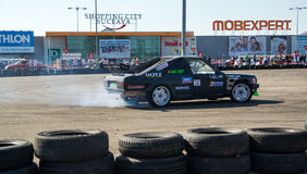Racing car in drift contest stock photo