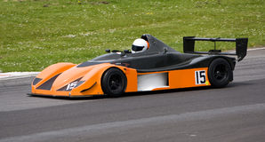 Racing Car. The driver of number #15 negotiates the track at Castle Combe, England royalty free stock photo