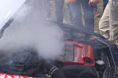 Engine failure. Racing car engine failure just after the race, bonnet opened, steam outside Royalty Free Stock Photos