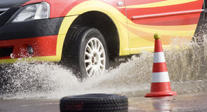 Racing car entering water Stock Images