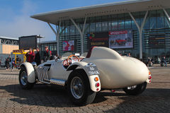 A racing car at the entrance of the motorshow Royalty Free Stock Photography