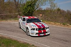 Racing car Ford Mustang drifting with smoking tires royalty free stock photo