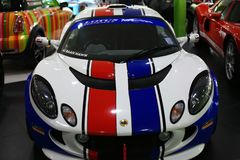Racing car Lotus elise. The Lotus Elise is a two seat, rear-wheel drive, mid-engined roadster conceived in early 1994 and released in September 1996 by the Royalty Free Stock Photography