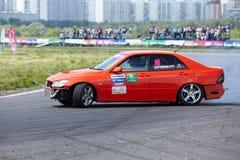 Racing car with pilot D.Kharchenko rides on track Stock Photos