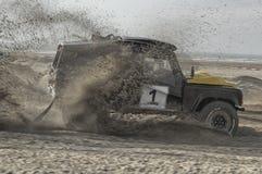 land rover car is racing on the beach stock photos