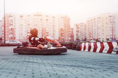 Racing car on the track in action, championship, active sports, extreme fun, the driver keeps his hands on the wheel. protective stock photography