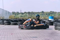 Racing car on the track in action, championship, active sports, extreme fun, the driver keeps his hands on the wheel. protective stock images
