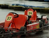 Racing cars. On wet asphalt Stock Image