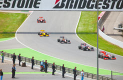 Racing cars on a  circuit during The Formula 1 Gra Royalty Free Stock Photo
