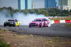Racing cars of M.Kostyuchik and K.Izotov on track Stock Images
