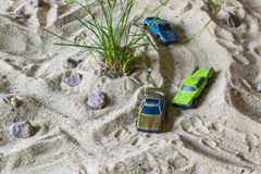 Racing cars on the sand compete in a game of survival. royalty free stock photos