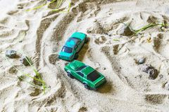 Racing cars on the sand compete in a game of survival. royalty free stock photography