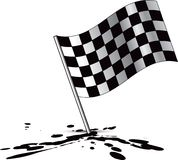 Racing checkered flag on oil splatter Stock Images