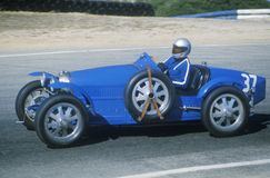 Racing a classic Bugatti sports car at the Laguna Seca Classic Car Race in Carmel, CA Stock Image