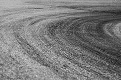 Racing curve. Black tire prints in racing curve Royalty Free Stock Photography