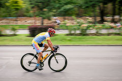 Racing cyclist on road, panning Royalty Free Stock Photo