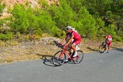 Racing Cyclist Stops On Hill. One of the riders stops as they climb a mountain on stage eight Xorret De Cati in the 2017 La Vuelta España bike tour Stock Image