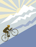 Racing cyclist  up a mountain Royalty Free Stock Photo