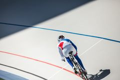 Racing cyclist on velodrome outdoor. Sport. Cyclist has a traning on a velodrome Royalty Free Stock Photography
