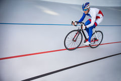 Racing cyclist on velodrome outdoor. Sport. Cyclist has a traning on a velodrome Royalty Free Stock Photos