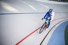Racing cyclist on velodrome outdoor. Sport. Cyclist has a traning on a velodrome Stock Image