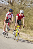 Racing Cyclists. Two cyclists racing closely together at high speed stock photography