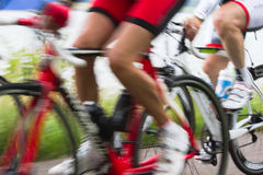 Racing cyclists at high speed. Close view on Racing cyclists passing by at high speed Royalty Free Stock Photography