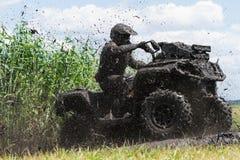 Racing on a dirt atv Stock Image