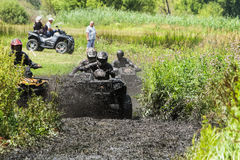 Racing on a dirt atv Stock Images