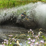 Racing on a dirt atv Royalty Free Stock Photography