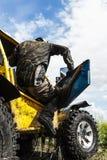 Racing on a dirt atv Royalty Free Stock Image