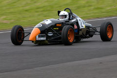 Racing Driver. A racing driver negotiates the Castle Combe circuit stock images