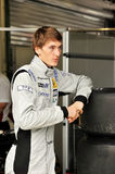 Racing driver in a paddock. Photo of Nikolay Martsenko - a talented russian pilot of Pons Racing Team in WSR 3.5 - caught in paddock giving out the time for Stock Photography