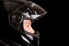 Racing driver. Posing with helmet isolated in black Royalty Free Stock Photography