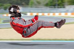 Racing driver. On track in driving position in full gear Royalty Free Stock Photography